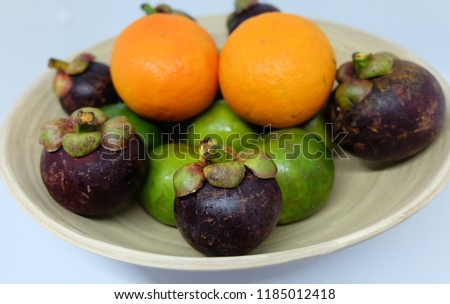Stock Photo Tropical fruits in the basket