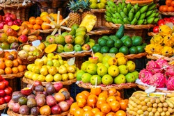 Tropical fruits on the famous market in Funchal, Madeira Island, Portugal. Exotic fruit. Banana, mango, passion fruit or avocado. Colorful food, healthy lifestyle.