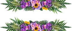 Tropical green foliage plant leaves with colorful flowers floral arrangement nature frame banner isolated on white background, clipping path included.