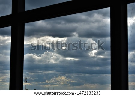 tropical grey clouds through iron built structure as background #1472133233