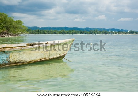 Tropical horizon with boat in the water