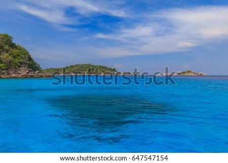 Tropical Island Beach And Fishing Boat With Clear Blue Lagoon Water At Lipe Island Satun