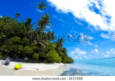 Tropical island beach with canoe