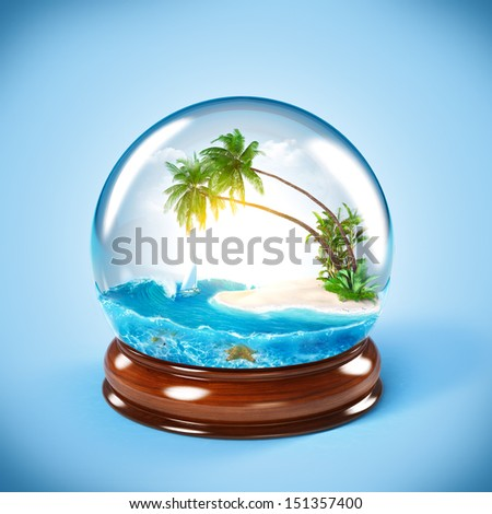 tropical island in the glass globe. Traveling, vacation