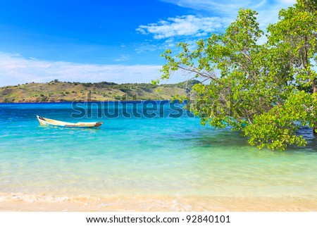 Tropical island landscape. Boat on the foreground