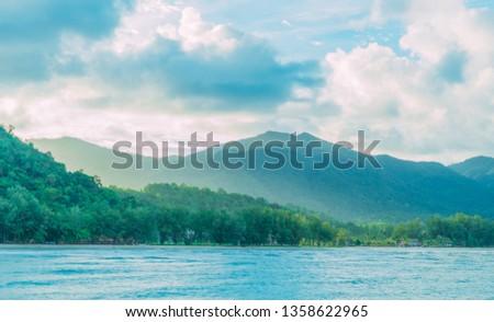 Tropical island mountains wallpaper texture. Vintage effect. Travel inspiration. Postcard concept.