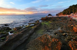 Tropical island of Apo at sunset. Philippines