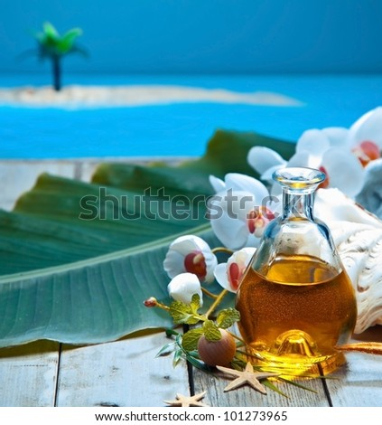 Tropical island retreat essential oil spa treatment with natural plant extracts and orchids - stock photo