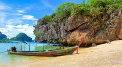Tropical island sea boat view. Sea boat on tropical island beach. Sand beach boat on tropical sea island