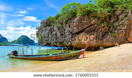 Tropical island sea boat view. Sea boat on tropical island beach. Sand beach boat on tropical sea island