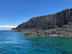 Tropical island, Taiwan Penghu County. Geological lava plateau. Black basalt columns protrude from the sea.