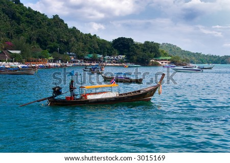 Tropical Island With Fishing Boat