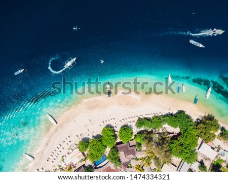 Tropical island with tropical beach and crystal ocean, aerial view. Gili islands #1474334321