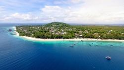 Tropical island with white sandy beach and blue transparent water. Gili trawangan island