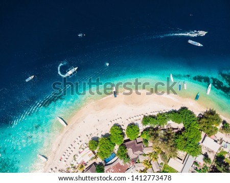 Tropical island with white tropical beach and turquoise crystal ocean, aerial view. Gili islands #1412773478