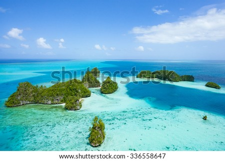 Tropical islands and clear blue water from above, Palau, Micronesia #336558647