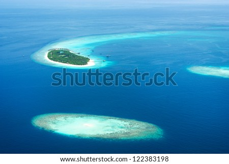 Tropical islands in Indian ocean from above, Maldives