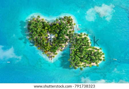 Tropical islands in the shape of two hearts. Aerial view. 3D illustration