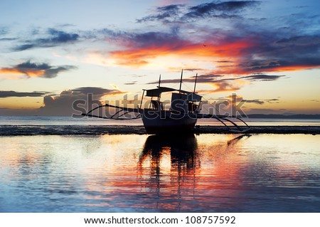 Tropical landscape with traditional Philippines boat at sunset, Philippines