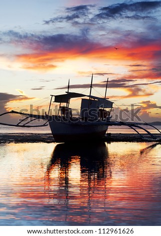 Tropical landscape with traditional Philippines boat at sunset, Philippines - stock photo