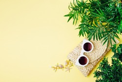 Tropical leaves and Beach bag with sunglasses  on  yellow  background. Top view, flat lay.