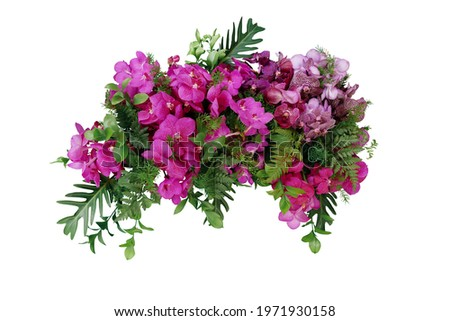 Tropical leaves and flower garland bouquet arrangement mixes orchids flower with tropical foliage fern, philodendron and ruscus leaves isolated on white background with clipping path.
