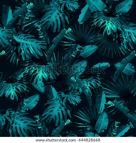 Tropical leaves pattern repeating. Foliage dark blue leaf exotic plants seamless. Artistic photo collage for floral print. Natural leaves palm, banana, monstera template background.