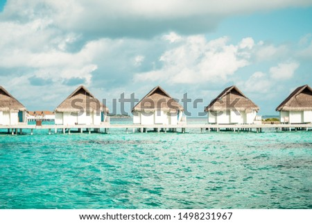 tropical Maldives resort hotel and island with beach and sea for holiday vacation concept - boost up color processing style #1498231967