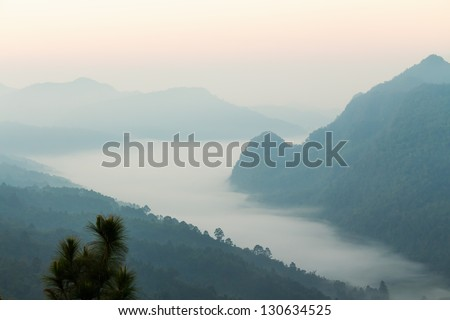 Tropical mountain ranges in the mist at dawn, northern Thailand