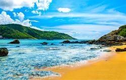 Tropical mountain sea beach landscape. Sea island sand beach view. Tropical sea sand beach landscape. Sand beach