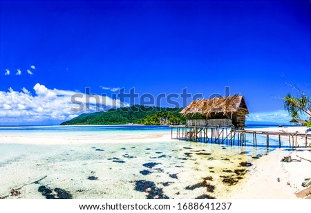 Photo of Tropical ocean beach bungalow landscape. Sea sand beach bungalow