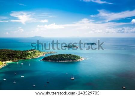 Tropical ocean landscape with Koh Kaeo island at turquoise ocean waives with boats near Ya Nui beach. Rawai, Phuket, Thailand #243529705