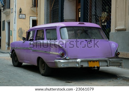 Tropical oldtimer parked in the streets of Havana #23061079