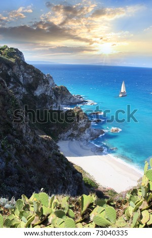 Tropical paradise with white beach against sunset - stock photo