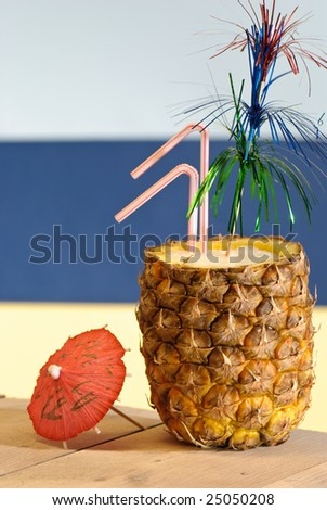 Tropical pineapple drink with straws and decoration