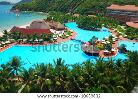Tropical pool in luxury hotel - stock photo