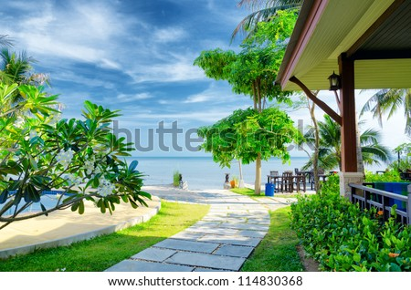 Tropical resort with swimming pool. - stock photo