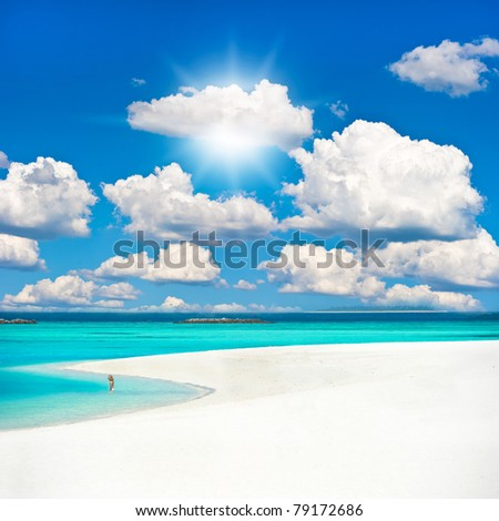 tropical sand beach over cloudy sky. holiday background.