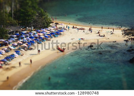 Tropical sandy beach and calm lagoon with clear blue water. Pseudo tilt shift. Ya Nui beach, Phuket, Thailand - stock photo