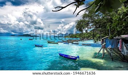 Tropical sea boat at Phuket island. Phuker boats on sea water at Phuket islands