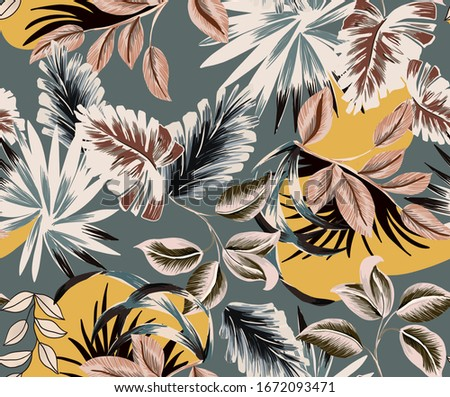 Tropical seamless pattern composed by vintage exotic colorful  leaf with teal background