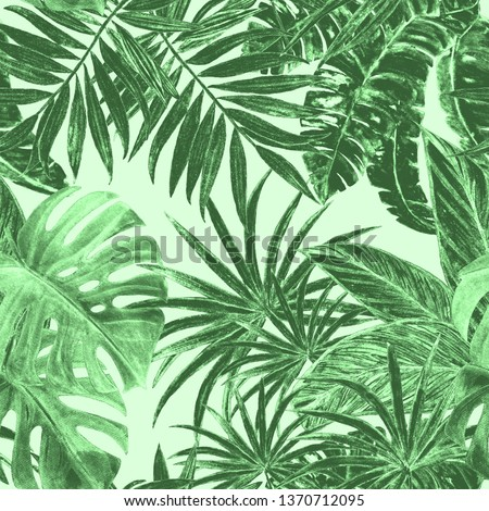 Tropical seamless pattern with jungle leaves: palms, monstera, calathea. Beautiful allover print with hand drawn exotic plants.