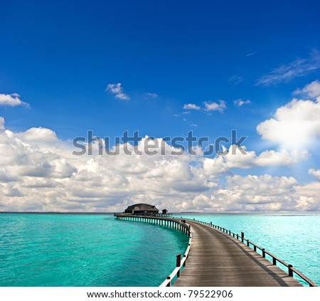 tropical seascape. over-water bungalow