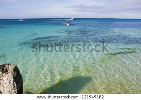 tropical seascape with blue sky and white boats
