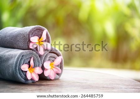 Tropical spa, beautiful fresh pink frangipani flower, outdoor setting spa