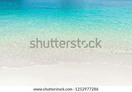 Tropical summer beach and transparent blue sea water background. Thailand sea. #1252977286