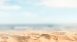 Tropical summer sand beach and bokeh sun light on sea background, copy space.