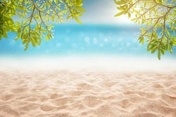 Tropical summer sandy beach focus area at sand floor and bokeh sun light on blurry sea and sky montage photo with plumeria branch as frame