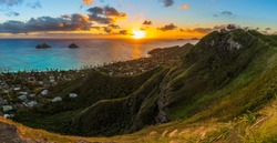 tropical sunrise over Lanikai Beach, Hawaii - from the Kaiwa ridge trail ( pillbox hike ) - see the mokulea islands, rabbit island, and makapuu