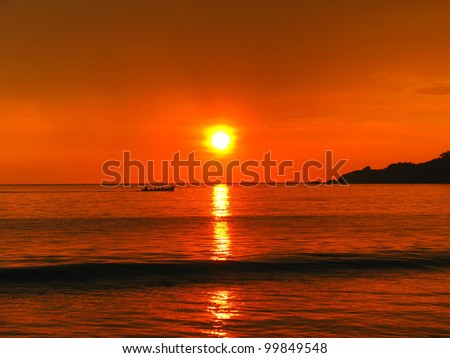 Tropical sunset on the Palolem beach, Goa, India